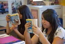 """Two eight grade students reading """"The Call of the Wild"""" in language arts class"""