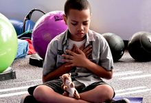 A child does relaxing breathing activities in a sensory space