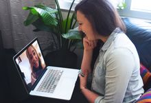 Two women talking via video chat on a laptop