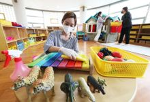 Teachers disinfect toys at Hanil Kindergarten in Suwon, South Korea, 26 May 2020. Millions of students throughout South Korea are expected to return to school on 27 May as the country gradually lifts coronavirus restrictions.