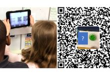 Two students looking at a QR code