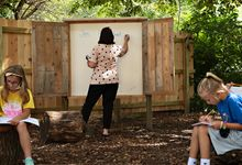 Students attend class in an outdoor classroom at Bentley Primary School