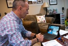 High school teacher conducts distance learning class via video chat