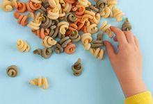 Child sorting dried pasta