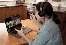 Woman at home on video conference call