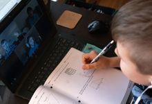 Boy completing math lesson via video chat during distance learning