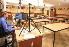 Science teacher Geoff Reilly teaches an online class from his empty classroom