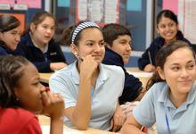 High school students listen to their teacher in class
