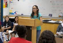 Middle school student speaks in front of her class