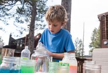 Boy does science experiment outside