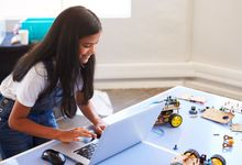 A middle school girl participates in a robotics club online