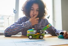 Boy tests a model car during remote learning