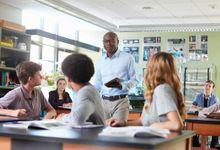 Science teacher talks to high school class