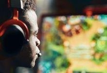 Teen boy plays a video game
