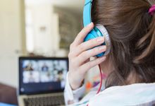 Teenage girl remote learning at home on laptop