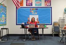 Elementary school teacher teaches virtually from her classroom