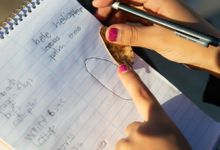 Student makes notes during outdoor science experiment