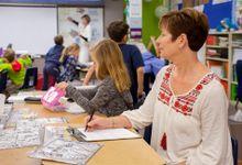 Educator observes teacher in the classroom