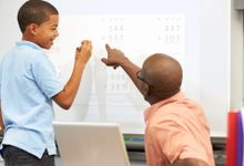 A student consults with his teacher about a math problem.