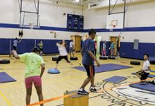 Students completing an obstacle course in gym class