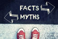 A student's shoes stopped in front of the words Facts and Myths written on ground