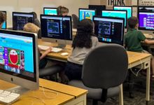 Kids in a classroom use a variety of programs to practice coding.