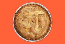 A whole apple pie with the Pi symbol baked in the crust