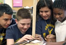 Kids working together measuring with a ruler