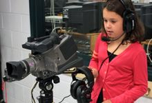 Young girl with video camera.