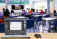 Photo of a classroom laptop open to a Google app