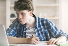 A boy does online research for an essay.