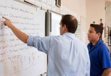 photo of teacher and student at whiteboard