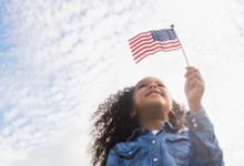 Girl holding an American flag.