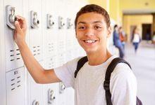 Boy at his locker outside hallway
