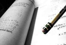 Pencil laying in a math workbook