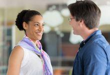 A teacher and a parent meet at a cafe.