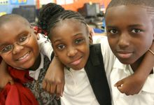 Three students smiling