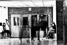 Image of students walking in a school hallway