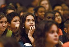Close-up of students listening