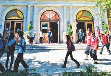 Kids walking in front of the school