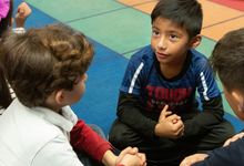 Students in elementary class talk in pairs and small groups.