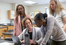 Teachers meeting in classroom