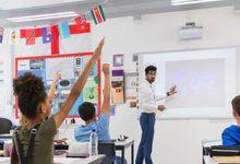 Teacher leading classroom via projector screen