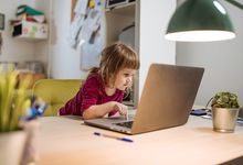 Pre-schooler distance learning on laptop at home