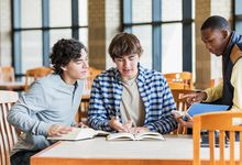 High school students work on group project