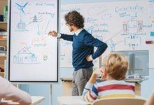 Teacher drawing diagram on a whiteboard