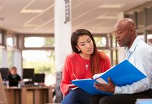 Teen and mentor talk at school