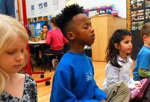 Students meditate at school