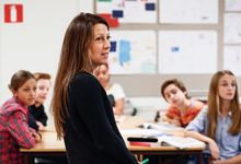 Middle school teacher in classroom with students