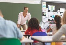 Elementary school teacher speaking to students